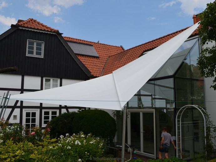 Hovestadt  Sonnensegel über Terrasse und Wintergarten