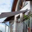 Sonnensegel manuell Büren 2M / 2W I. graues Segel über einen Balkon