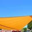 Sonnensegel - elektrisch - in Ascheberg in Gelb vor Supermarkt