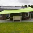 Sonnensegel elektrisch Bodenstedt 3M / 1W I. grünes Sonnensegel vor einem Haus