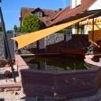 Sonnensegel feststehend Niedernberg 2M / 2W oranges Segel über einen Koiteich