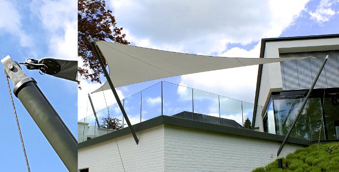 Textiles Bauen - Sonnensegel auf einer Terrasse an zwei Masten mit Seilen abgespannt